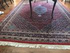 Lovely area rug. Colors of light blue, dark blue, and red.