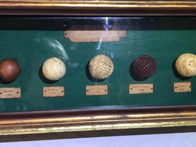 Development of the golf ball display in a shadow box.