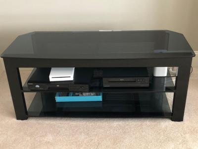 Glass top TV stand items on stand not included