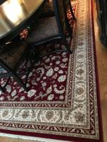 Persian Renaissance area rug by Kerastan. Colors of burgundy and off white.