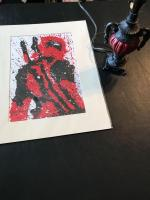 Print signed by artist Kateryna V. and red lamp