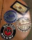 4 metal signs - 3 Budweiser and 1 Bacardi silver