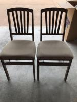 Two wood folding chairs with upholstered seats.