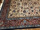 Beautiful wall area rug in colors of 10 rust blue and green