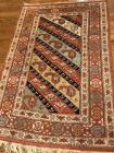 Small area wool rug in colors of Rust, Navy, Turquoise and tan