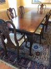 Dining table With two arm chairs and four side chairs and has two leaves