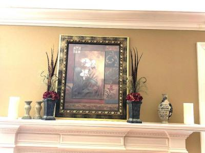 Framed print with decorative items on mantle