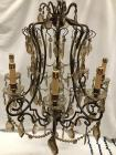 Gorgeous bronze colored chandelier. Highly decorated with glass prisms. Very ornate and intricate.