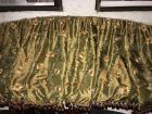 A beautiful floral cornice board valance in colors of tan,brown, and green background.