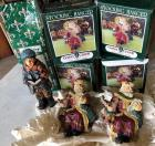 4 Resin Santa Stocking Hangers and 1 caroling boy figure - with retail boxes