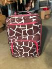 Cute Giraffe print with pink trim rolling suitcase - in good condition!