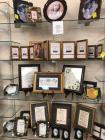 Grouping of picture frames and framed Bible verses and sayings