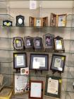 Grouping of picture frames and framed poems and scripture