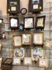 Grouping of picture frames and framed verses and sayings