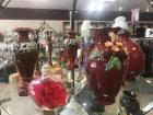 Shelf of decorative items in colors of maroon