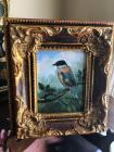Small framed oil painting of bird in decorative frame
