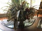 Lovely silk flower arrangement with feathers in pedestal container