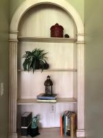 Decorative items on the shelf with books