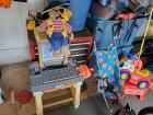 Childrens lot. Include stroller, workbench, ride on toy, outdoor chair, and animated bear with pins.