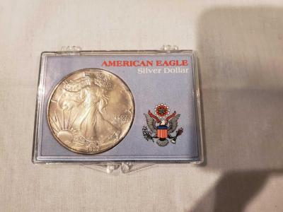 American eagle silver dollar. 1990. Weighs one troy ounce