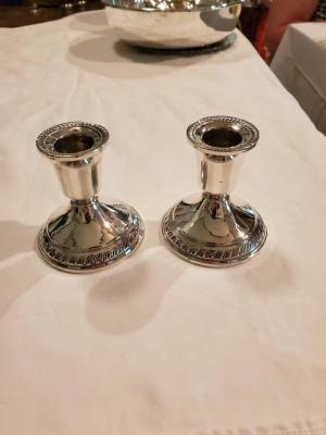 A beautil pair of sterling weighted candle holders