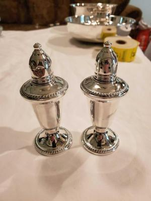 A beautiful sterling weighted salt and pepper shaker