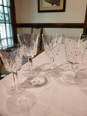 Four Waterford stemware wine glasses.