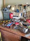 Contents of work bench (doesnt include work bench), plus a tool box and contents