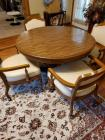 A short kitchen table with 4 short captain chairs
