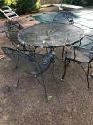 Round outdoor table with four chairs, table needs repaired (table top is not attached)