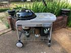 Round Weber grill for charcoal or gas with stand