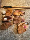 Baseball gloves balls and bats