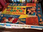 Give a show vintage projector set, large collection of children's puzzles