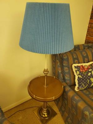 A vintage end table with a built in lamp