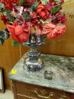 A beautiful silver plated flower pot with faux flowers