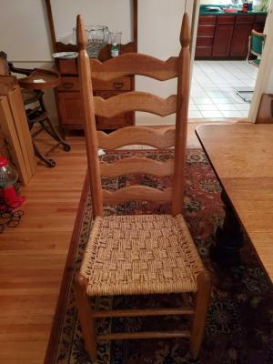Four antique hand made ladder back chairs from north Carolina.