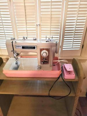 Wonderful vintage brother opus 191 sewing machine in a pink case. Sewing machine has several decorative stitches and is in working order.