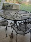 A nice patio table and 4 chairs