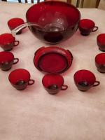 A very nice red glass punch bowl on a stand, with 9 glasses and a ladle