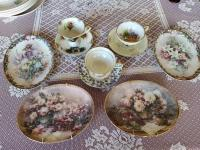 Grouping of decorative tea cups and plates.