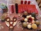 Decorative tray with beads and balls, Christmas napkins, and candles.