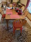 Wonderful oak table and 5 Windsor back chairs. Contents on table not included.