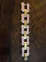 Costume jewelry bracelet, gold with pink