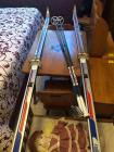 Pair of cross country skis with shoes and poles