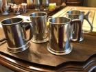 Prewter mugs, three with glass bottoms and one with solid bottom