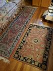 A pair of area rugs, 1 is 46 x 30, the other is 90 x 24