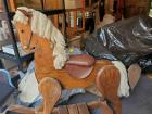 Vintage wooden rocking horse with leather saddle and yarn mane