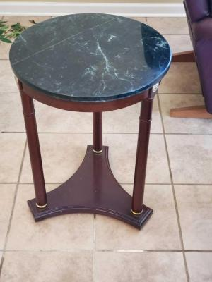 "A round marble topped accent table, 25"" tall, diameter of 18"""