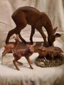 A grouping of 4 deer figurines