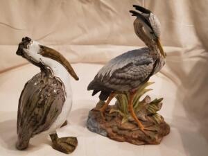 "A 9"" pelican sculpture signed by the artist, and an Andrea, great blue heron (10"")"